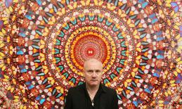 Damien Hirst in front of his work I Am Become Death, Shatterer of Worlds